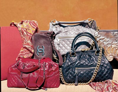 "Red Chanel leather and calfskin handbag, Chanel brown distressed leather shoulder bag, ""mouse"" quilted handbag from Carlos Falchi, black quilted and chained Marc Jacobs handbag, and Etro paisley challis scarf, all from Saks Fifth Avenue."