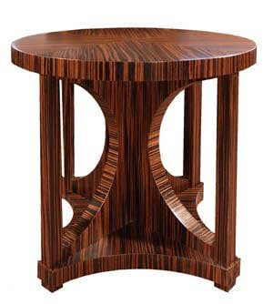The Heliotrope Table in macassar ebony by Palm Springs designer Mark Newman was inspired by the silhouette of an hourglass. Its curves and cutouts make a graceful statement. And in two sizes and 12 finishes, it can be an end table, dining table, or bedside table.  To the trade only. (800) 871-7701