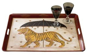 """Commissioned by New Mexican artist Ford Ruthling (four of his Pueblo pottery paintings have been used on U.S. stamps), this wooden tray (26.5"""" x 20.5"""") displays an unusual combination of an old-fashioned parasol, buzzing bees, and a strutting Bengal tiger; $139. (800) 320-9757"""