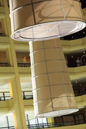 Massive framed linen lanterns in the atrium merge modern art and function.