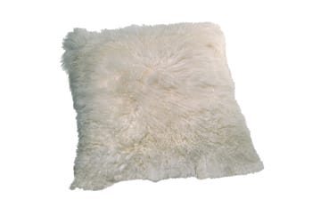 Curl up on this luxuriously shaggy oversized floor pillow made of 100 percent Tibetan lamb wool; $449. Interior Illusions, 830 N. Palm Canyon Dr., Palm Springs, 325-0300, www.interiorillusionscalifornia.com. Photo by Taylor Sherrill.