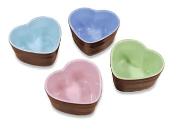 Sized for single-serving soufflés or crème brûlées, Le Creuset's enameled stoneware Spring Heart Ramekins reveal lavender, pink, sky blue, or grass interiors when dessert is gone; $40/set of four. Williams-Sonoma, 73-505 El Paseo, Palm Desert, 862-1290, or www.amazon.com.