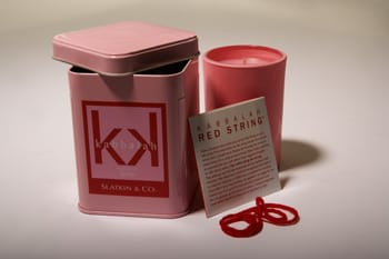 "Special edition ""The Power of Love"" Kabbalah deluxe scented candle by Slatkin & Co. will woo you during its 45-hour burn time with scents of peony, sandalwood, tangerine, and rose. Includes a blessed, red string bracelet to be worn on your left hand to protect against evil; $22. Home 101, 392 N. Palm Canyon Dr., Palm Springs, 318-9886, www.home101store.com. Photo by Taylor Sherrill."