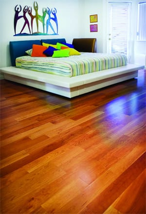 A Palm Springs couple wakes up to these tawny cherry wood floors in their master bedroom.