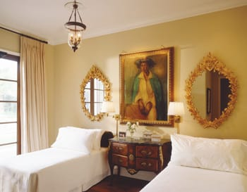 Large and dramatic works of art in the master bedroom (Ted Tuttle 14) and guest bedroom (Ted Tuttle 15) are enhanced by antique lighting fixtures and neutral bedding and window treatments.