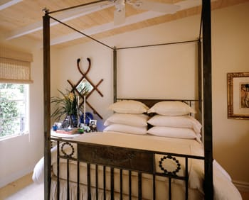 Antique beds lend a timeless touch to the master bedroom (Ted Tuttle 12) and guest bedroom (Ted Tuttle 13)