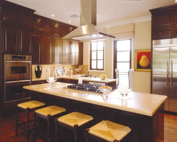 The cooks relish the kitchen's abundant storage, room to move, and seating for four friends to snack and chat during preparations.