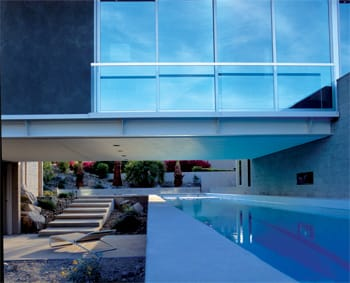 A 75-foot lap pool is fully integrated into the architecture, design, and lifestyle of homeowner Bob Greenbaum. He enjoys its soothing hue and water element from many angles throughout the home.