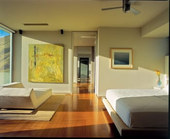 Bamboo — this time as flooring — makes another appearance in the bedroom, where views are of the mountains instead of the pool.