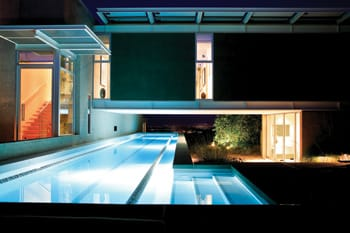 The pool's color and glow transform the home's look and feel depending on the time of day and whether it is viewed from the inside or out