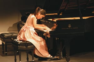 At 12, Elaine Zhong was the second-place winner in the junior solo division of the 2005 Virginia Waring International Piano Competition. Photo: Loretta Vlach
