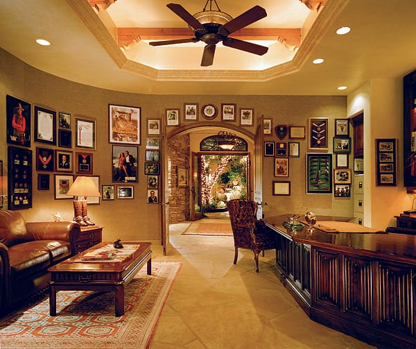 John's office is filled with photos and letters from cowboy legends and awards from his military career, among other memorabilia.
