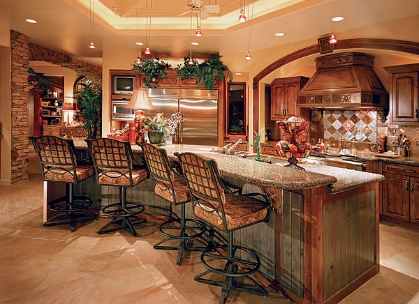 A copper hood hangs above the range and the custom backsplash with the honeymoon tile from Italy. Barstool seating in the open kitchen means guests can watch as Nikki, who is involved with Les Dames d'Escoffier International, works her culinary magic.
