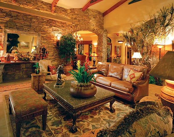 The couple's collection of Western art and artifacts blends in with the warm tones of the great room.