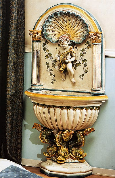 The cherub on this clamshell-and columns fountain from Old World Pottery in Palm Desert has caught himself a fish; $3,740. 73-375 El Paseo, Ste. E, 774-7208, www.oldworldpottery-online.com.