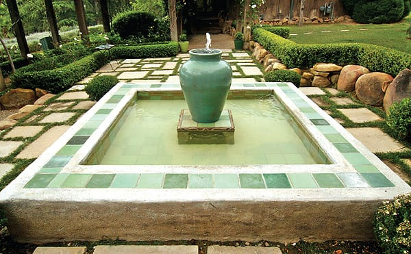 Landscape designer Paul Hendershot designed this fountain with a pottery focal point and a mix of antique and new tiles for his Craftsman-style home. The tiles pick up the design from the surrounding geometric pathway. He chose new tiles from RTK Studios in Ojai, which specializes in hand-glazed tiles fashioned after those made in the 1920s and '30s. Photo credit: Timothy Swope