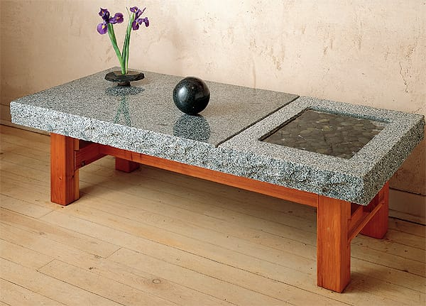 A portion of the hand-carved granite top of the Slab Table/Bench by Stone Forest is devoted to a recessed area that can hold whatever moves you. They like river rocks covered with shallow water, which adds moisture to indoor air as it evaporates. Shown with an Indian Rosewood base; $870. (888) 682-2987, www.stoneforest.com.