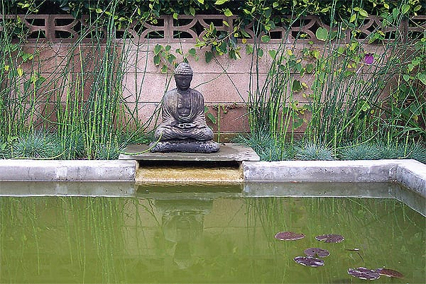 Buddha and other Asian elements are popular choices for water features designed to promote peace and tranquility, like this reflection pond designed by Green Scene Landscape. Photo credit: greenscenelandscape.com