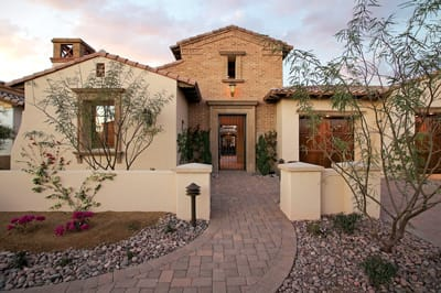 """The homes themselves were designed to evoke a sense of the Old World. Six floor plans, each with three elevations, offer distinctive details such as ornate chimney caps, """"overgrouted"""" bricks, and wrought iron. Tumbled stone replaces concrete in walkways and driveways."""