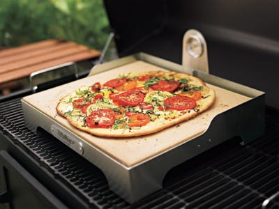 Pizzas cooked on this grill-top pizza stone boast a traditionally crisp crust and bubbling-hot toppings simply by using the high heat of your gas grill. The stone and its raised stainless-steel frame come with an attached thermometer and tempting recipes for grilled pies; $99.95. Williams-Sonoma, The Gardens onEl Paseo, 73-505 El Paseo, Palm Desert, 862-1290, www.williams-sonoma.com