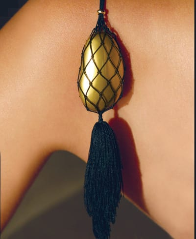 Elsa Peretti wood and lacquer pendant in net with silk fringe from Tiffany & Co. at The Gardens on El Paseo in Palm Desert.