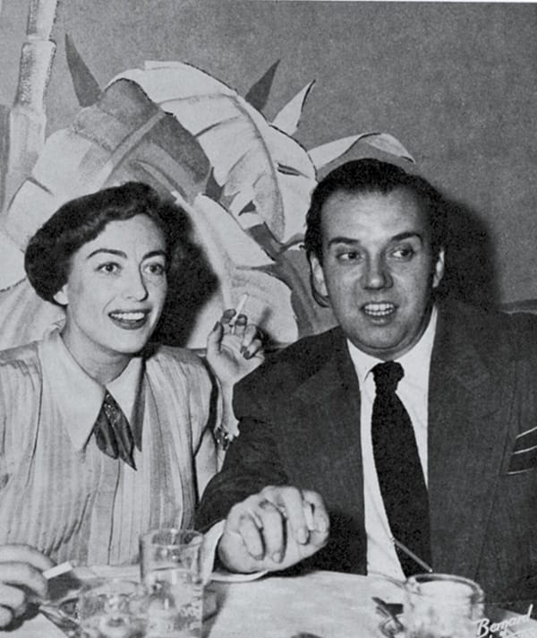 Joan Crawford and impersonator Arthur Blake.