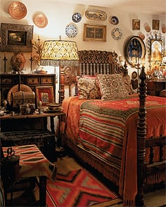 A 17th century carved walnut marriage bed with treadle-lath spindles and chip carving is dressed with a 19th century Mexican serape. On the floor is an 1890 Navajo saddle blanket. Collections of Hispano-Moresque copper lusterware, Spanish colonial silver, and a rare 18th century Spanish colonial tortoiseshell and silver jewel casket are arrayed on an 18th century Spanish desk. Above the desk are an 1800 floral image with a Mexican silver frame and 18th century Italian silver and wrought-iron candelabras. A 19th century Hispano-Moresque lusterware urn holds center stage.