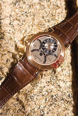 Harry Winston 18K rose gold retrograde dial with brown crocodile band from Leeds & Son Fine Jewelers. ($31,500)