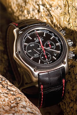 Ebel chronograph watch with black leather strap accented with red stitching from b. alsohns jewelers at The Gardens on El Paseo. ($5,200)
