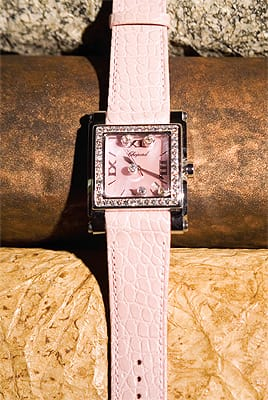 Chopard pink watch with diamond bezel, floating diamonds on mother of pearl dial, and pink crocodile watch band from Frasca Jewelers on El Paseo in Palm Desert. ($18,700)