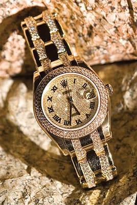 Ladies Rolex Pearlmaster 18K gold with diamond dial, diamond bezel, and two-row diamond bracelet from Leeds & Son Fine Jewelers. ($75,750)