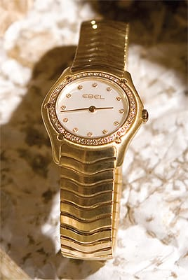 Ladies 18K gold Ebel Wave with diamond bezel and mother of pearl dial from b. alsohns jewelers. ($15,900)