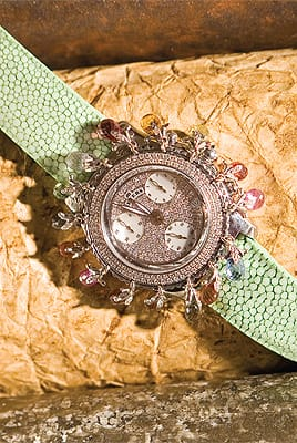 Ladies Meyers watch with sapphire briolettes and diamonds surrounding dial on pastel green alligator band (interchangeable bands available) from Frasca Jewelers. ($15,730)