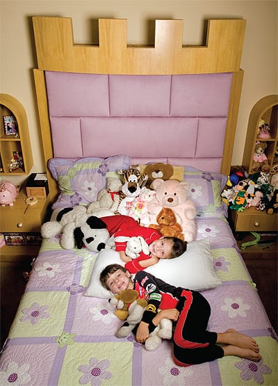 Jillian and Chandler Barbato make room for Jillian's collection of stuffed animals in her fairy tale bedroom.