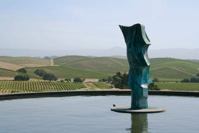 A sculpture by Catalan artist Marcel Martí graces the fountain overlooking an undulating landscape of vineyards at Aresa Winery.
