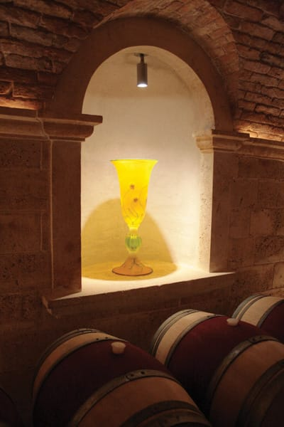 Alcoves lining the Hall wine caves showcase small sculptures and glasswork.