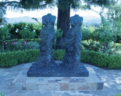 Jim Dine's Twin Venuses of Thunder stand on the edge of the gardens at Cliff Lede Vineyards.
