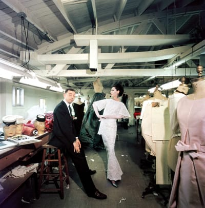 Slim Aarons photographed James Galanos and his impeccably dressed model in Galanos' workroom in 1960.
