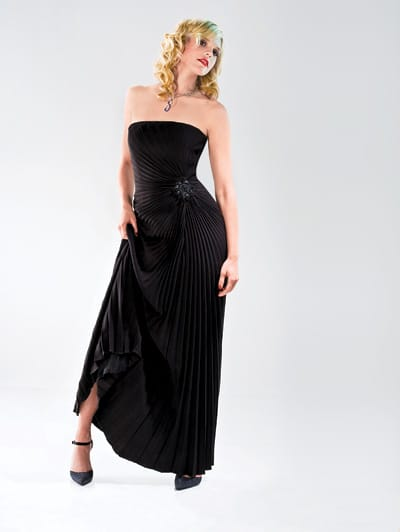 Black-pleated David Meister evening dress and black satin and crystal ankle strap shoes from dot women. Rodney Rayner diamond and sapphire twisted necklace from Frasca Jewelers.