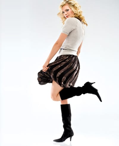 Rozae Nichols brown pleated sequin bubble skirt and cashmere and angora sweater with jeweled and ribbon detachable collar, W. Kleinberg skinny patent leather belt, and Cole Haan tall suede boots from Saks Fifth Avenue.