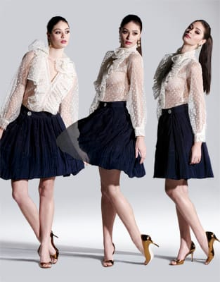 Tulle point d'esprit blouse with ruffled neckline and navy silk bubble skirt. Bronze/gold Manolo Blahnik open-toe pumps from Saks Fifth Avenue. Elizabeth Rand gold and diamond flower-drop earrings from Frasca Jewelers.