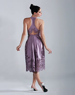 Lavender silk halter dress with cutout re-embroidered skirt. Norman Covan sapphire drop earrings from Frasca Jewelers. Shoes from Rangoni of Florence on El Paseo in Palm Desert.