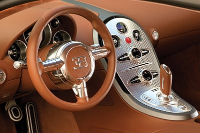 After inserting yourself into the Veyron, drivers find a refreshingly simple dashboard with at least one decadent feature: a power meter.