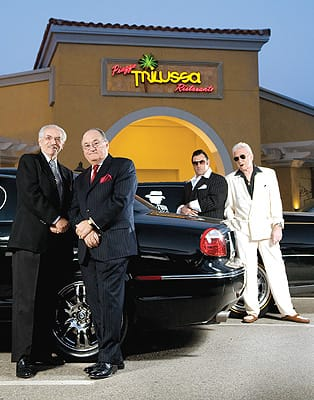 Ben Cusumano, Sam Pace, Ofer Gabriel, and Vince Guccione attract attention at a Cathedral City restaurant. Gabriel came up with a logo (shown on car windows) that reflects the 1940s style The Wise Guys admire. With interest from others in Las Vegas and Brooklyn, he plans to create a Web site to promote Wise Guys ideals and products.
