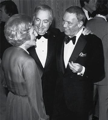 Leonore and Walter Annenberg with Frank Sinatra.
