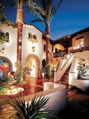 Architect Frank Stolz of South Coast Architects Inc. created a dramatic courtyard entry for a two-story Spanish-styled villa.