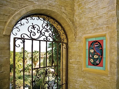 Rock walls and brickwork added by Dave Johnston feature arched windows for relief and views.
