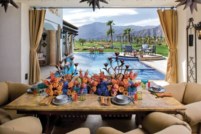 Say It With Flowers - Keith Laverty Design transformed the dining table of Casa Venosa, the private residence of Deb and Andy Moshier at The Hideaway country club in La Quinta. With the homeowners' personal dinnerware collection and the desert views as inspiration, Laverty set the table for an elegant evening at home with contrasting arrangements of purple and orange flowers. (714) 396-0302, www.kjlaverty.com.