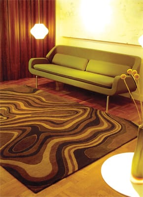 "Give it a Swirl - As fluid, organic, and tempting as a dish of olive oil and balsamic vinegar is The Liquid Rug by Delinear. Choose your custom mix of colors from a large selection and order it in any dimension. Made of 100 percent Himalayan wool, the rug is hand-knotted in Nepal. Over wool? The collection is also available in other fibers, such as hemp, banana, jute, and cactus. The company will feature its ""green"" collection in Ford Motors' next hybrid models; $6,400 for the 8-by-10-foot rug in 100 knots per square inch. Passages, 69930 Hwy. 111, Rancho Mirage, 328-4550."