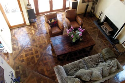 A Notch Above - The decision to install wood flooring has as much to do with which wood you select as how you decide to lay it down. Length and thickness of plank, direction, and pattern can alter the look significantly. The living room below is a cozy showcase for antique French oak flooring in the Parquet Versailles pattern, lightly hand-scraped and paste-waxed. Enchanted Woods, 150-D West Cypress Ave., Burbank, (800) 273-4730.